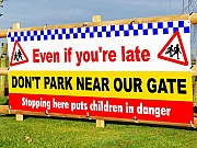 DON'T PARK NEAR OUR GATE